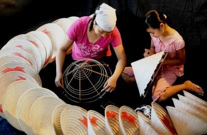 Workers in the Chuong village creating the hats by hand.
