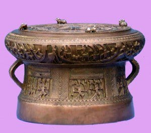 The Trong Dong Ngoc Lu drum with intricate carvings depicting characters wearing the conical hat.