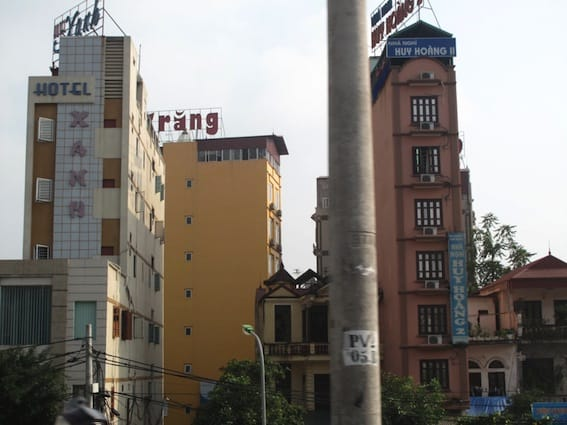 Many of the tall narrow houses in Vietnam have been converted into hostels or budget hotels.