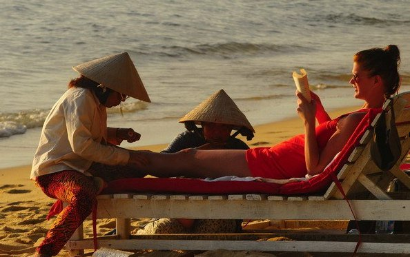 foot massage on beach