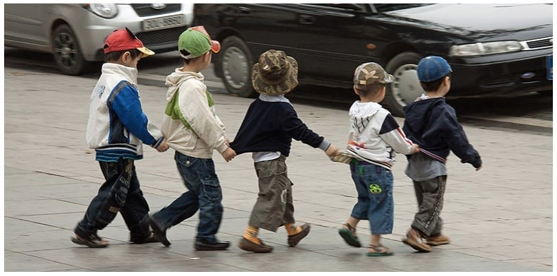 Local children crossing the road in Saigon, although we recommend that they have adults on either side of them.