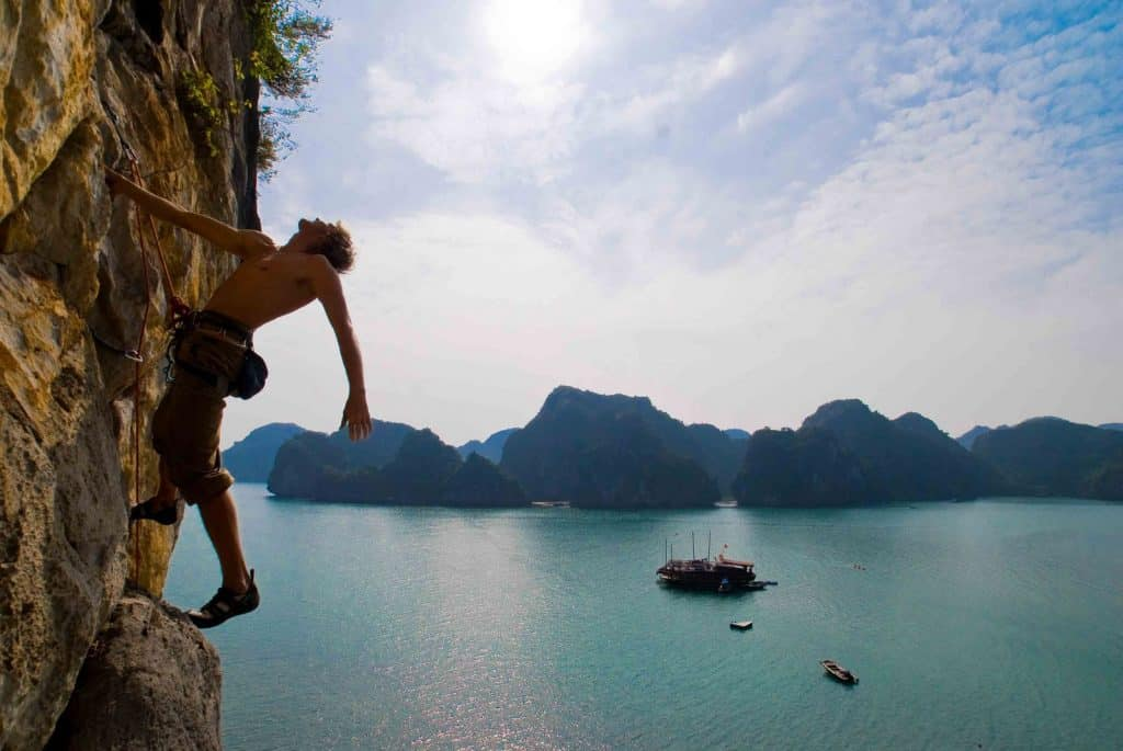 climbing with a beautiful landscape blue sea in Cat Ba Island, Vietnam