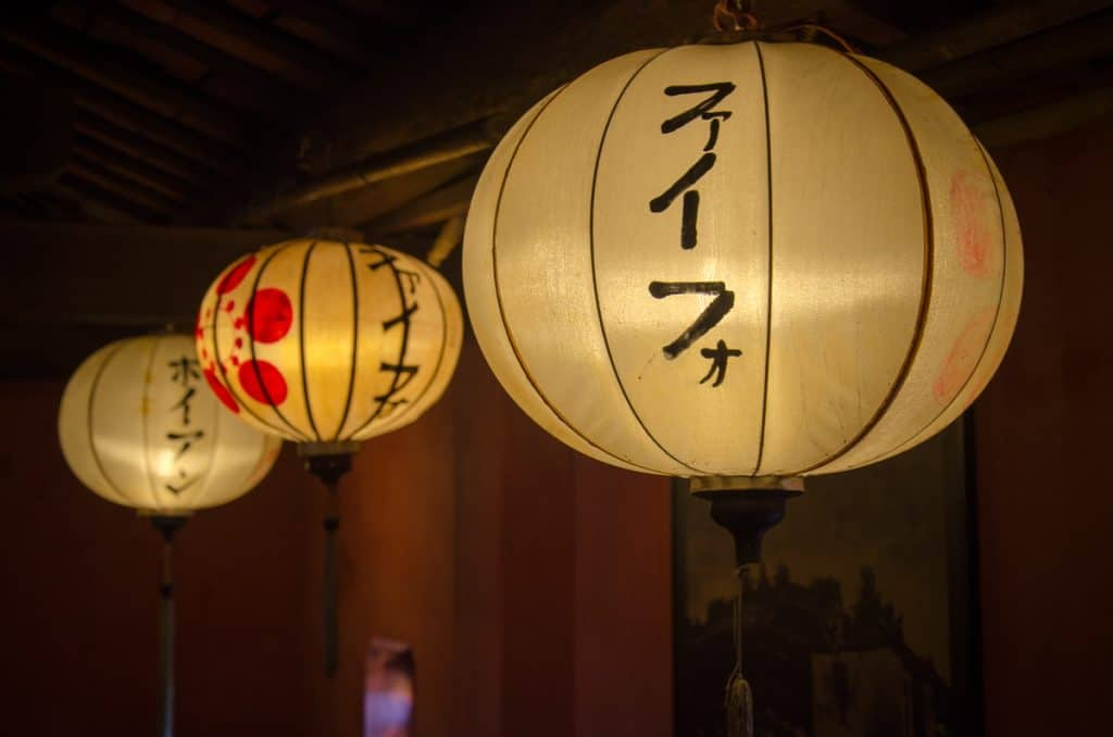 Lanterns with Japanese writings are lit all over Hoi An at night