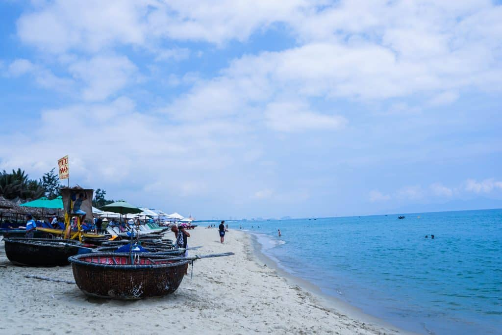 Hoi An beach with fishing boat and blue sky