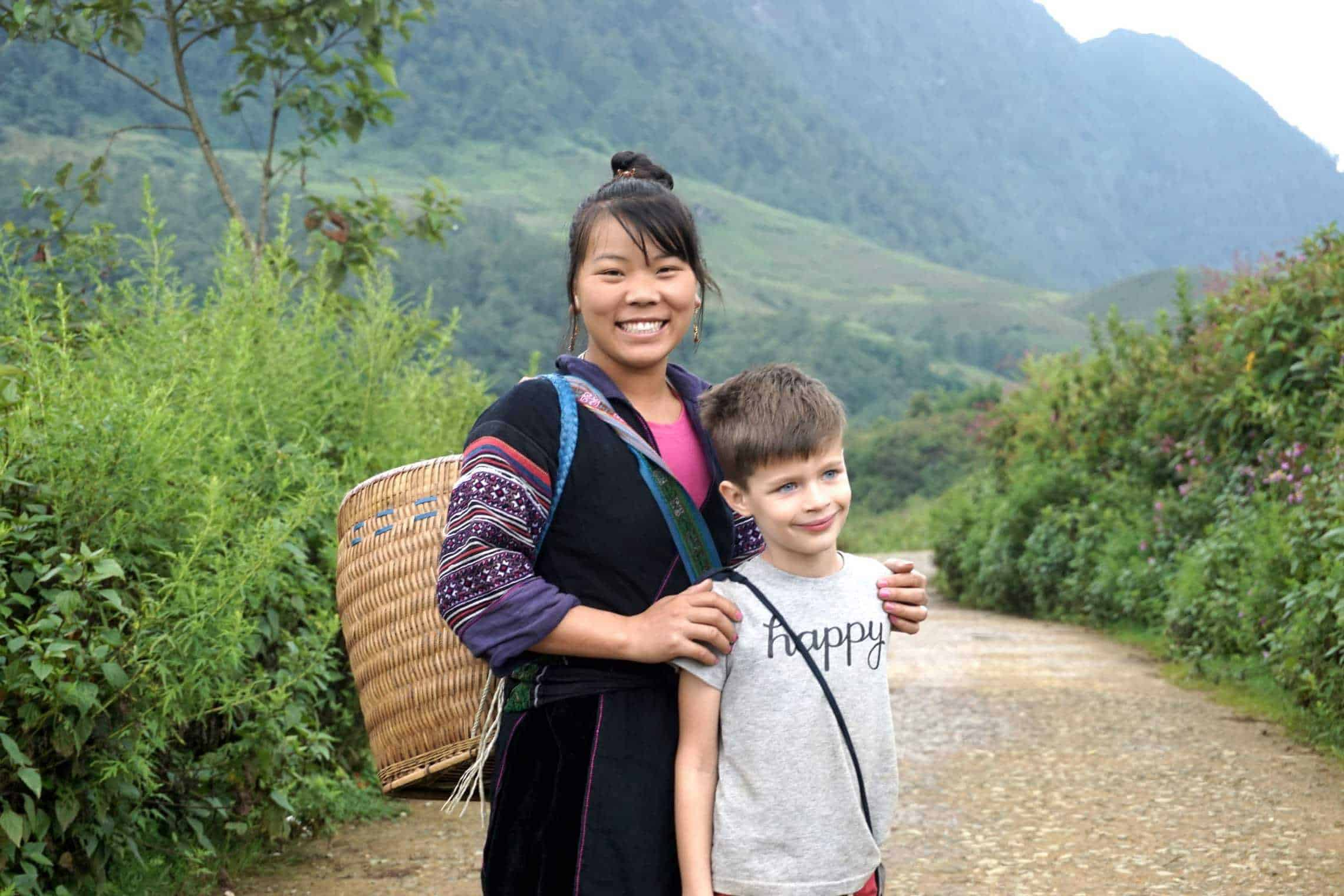 Ethnic villager in Vietnam posing with a foreign child