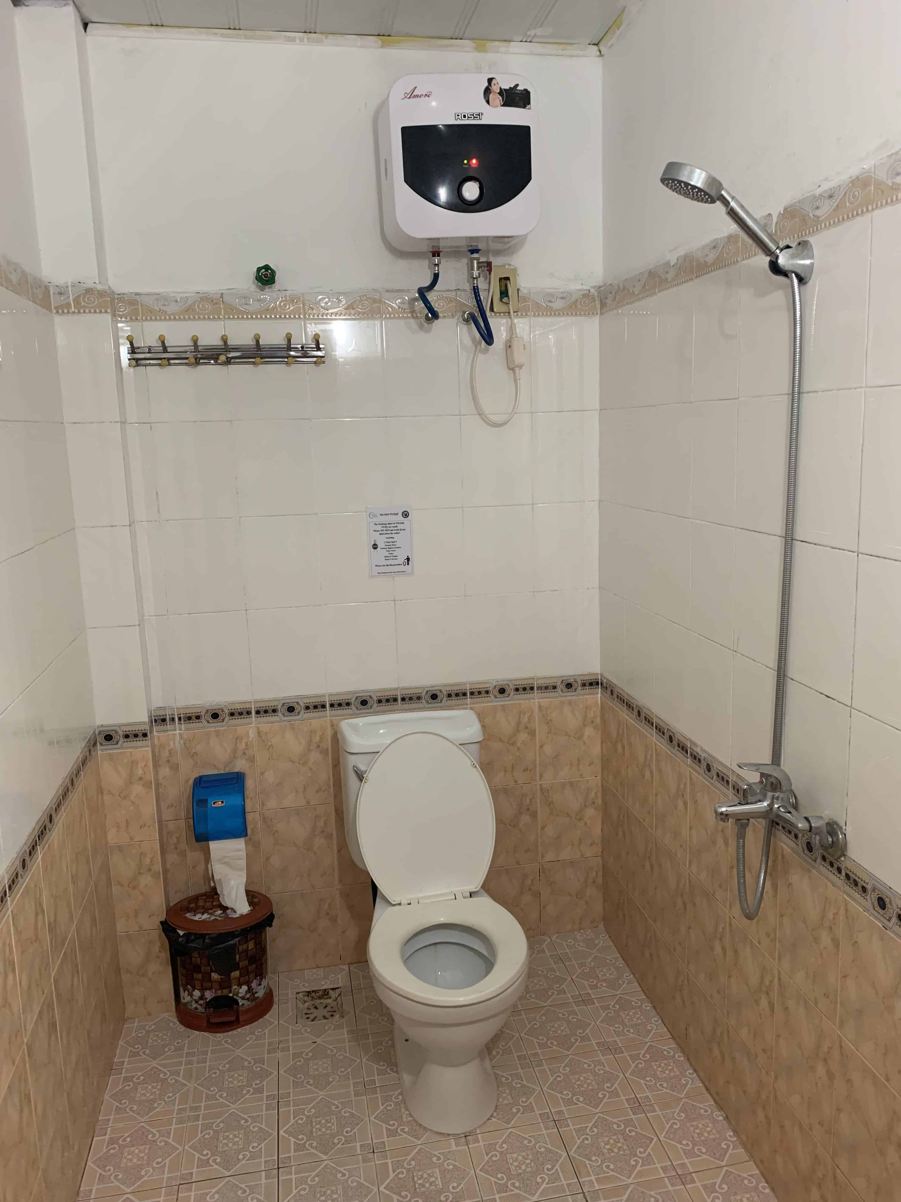 No divider between shower and toilet