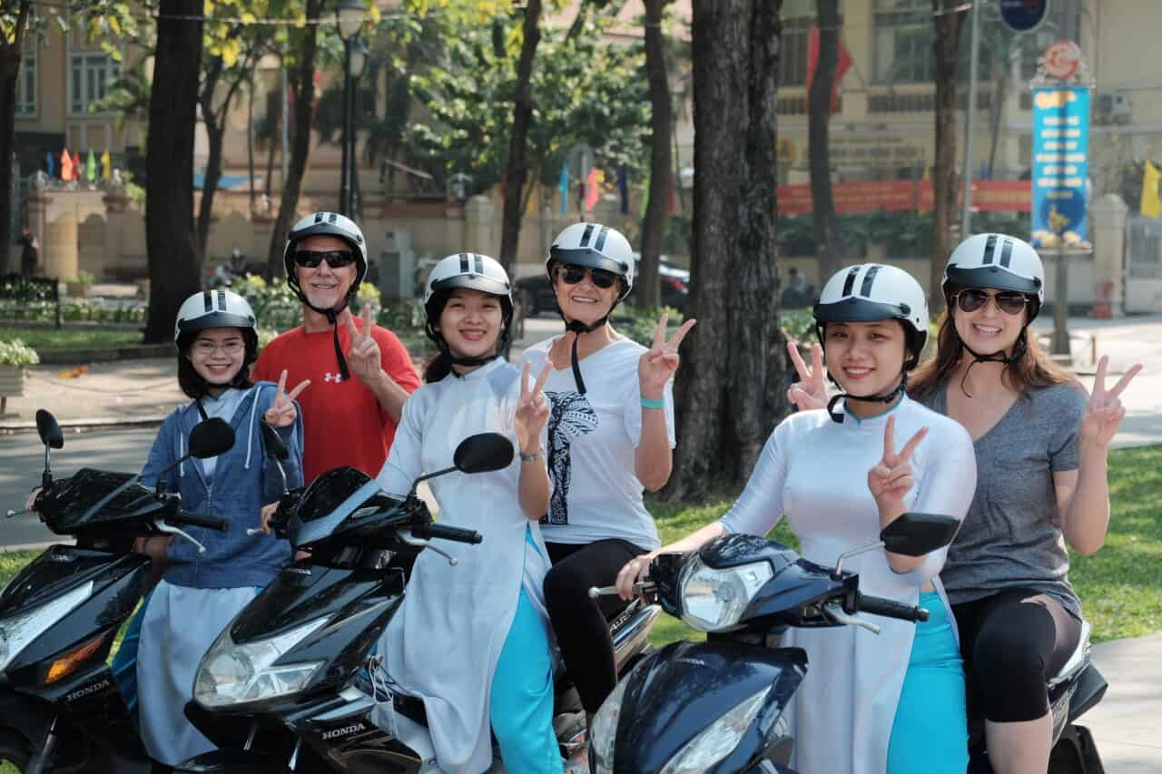 posing for photos on the Sights of Saigon Tour